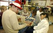 Free State High School senior Stephen Moles, 17, donned a Dr. Seuss hat to read to Linda Anguiano's second-grade class at Quail Run School on Friday morning as part of Read Across America 2002 festivities.