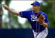 Royals pitcher Paul Byrd delivers during Kansas City's first spring-training game. Byrd allowed one run in two innings in the Royals' 5-3 loss to Detroit on Friday in Lakeland, Fla.