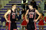 Lawrence High senior guards D.J. Watkins, left, and Stephen Vinson, seen talking strategy during the Topeka Invitational Tournament in January, average a combined 33.5 points a game for the Class 6A state tournament-bound Lions.
