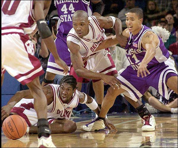 Oklahoma's Jabahri Brown, left, and Daryan Selvy, center, battle for a loose ball with Kansas State's Larry Reid. Oklahoma outrebounded K-State 54-30 on Friday in the Big 12 quarterfinals and rallied for a 63-52 victory at Kemper Arena in Kansas City,