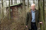 """William Heyen stands in front of his backyard cabin in Brockport, N.Y. In this Erie Canal village nearly 400 miles from ground zero, Heyen gathered poems, memoirs, letters, essays and fiction from his literary colleagues in the months after the terrorist attacks and turned them into the new anthology """"September 11, 2001: American Writers Respond."""""""