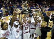 OKLAHOMA PLAYERS, including Big 12 player of the year and tournament MVP Stacey Dales (21), hold up their trophy after defeating Baylor, 84-69, in the championship game. The Sooners claimed their first league tournament title Saturday night at Municipal Auditorium in Kansas City, Mo. OU coach Sherri Coale is at far right.