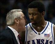 KU coach Roy Williams, left, gives Kansas freshman Keith Langford an earful.