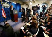 President Bush answers questions during a news conference at the White House. The president talked tough on Saddam Hussein, Osama bin Laden and the use of nuclear weapons.