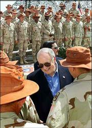 Vice President Dick Cheney greets Arkansas National Guard troops on peacekeeping duty in Sharm el-Sheikh, Egypt, during his Middle East mission to build support for President Bush's anti-terrorism campaign.