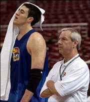 KU junior Nick Collison and coach Roy Williams watch practice Wednesday at the Edwards Jones Dome in St. Louis.