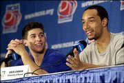 Kansas junior Drew Gooden, right, answers a question about people calling him Dwight Gooden during a news conference as Jeff Boschee laughs. The Jayhawks were discussing tonight's NCAA Tournament game against Holy Cross at the Edward Jones Dome in St. Louis.