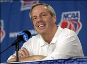 Ku coach Roy Williams answers a question from the media after Wednesday's practice in St. Louis.