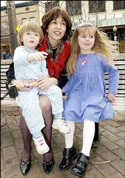 Rep. Patricia Lightner, R-Overland Park, and her two adopted daughters Caterina, 2, left, and Isabella, 4, meet outside a Lawrence restaurant where Lightner was meeting her husband, David, for lunch. Lightner has introduced legislation that would deny the Kansas Department of Social and Rehabilitation Services' help to adoptive parents of Kansas foster children.