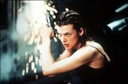 "Milla Jovovich stars as an elite agent in the video-game adaptation ""Resident Evil."""