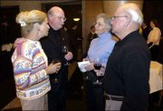 Former Lawrence residents, from left, Vivian and Larry Monckton, now of Alton, Ill., visit with Mary Kay and Bob Stephens, Lawrence, at a Kansas University Endowment Association gathering in St. Louis. Larry is a graduate of the KU School of Medicine in general surgery and Bob is Chairman of the Board of Stephens Real Estate in Lawrence.