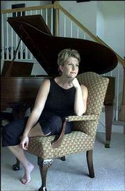 Joyce DiDonato, a Kansas City area opera singer, has received the 2002 Richard Tucker Award, considered opera's most prestigiousprize. She is shown at her Clay County, Mo., home in this August 2001 photo. The annual award carries a cash prize of $30,000.