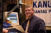 Bryan Thompson, Salina-based children's health reporter for Kansas Public Radio, produces a syndicated series for KANU and its affiliates. Thompson was photographed in February in the KANU studios in Broadcasting Hall at Kansas University.