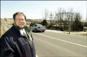Former state representative John Solbach discusses a county project on Stull Road in 2002. The former state representative is recovering after being badly injured in an April 18 accident on that road, near his home in western Douglas County.