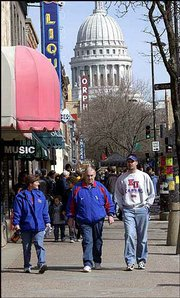 From left, Kim Miller, Lawrence; Ron Jeffries, Wellsville, and his son Jason Jeffries, Lincoln, Neb., enjoy Saturday afternoon on State Street in Madison, Wis.