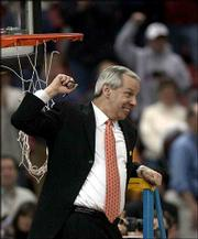 Kansas is celebrating its first Final Four berth since 1993. Coach Roy Williams, shows his happiness at a net-cutting ceremony after the Jayhawks' 104-86 win Sunday over Oregon.