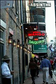 The Old Absinthe House Bar sign still hangs on the building where the Mango Bar now sells frozen daiquiris on Bourbon Street in New Orleans. Musical heritage preservationists hold up the change at the former blues bar as another example of how local landmarks are deteriorating in New Orleans.