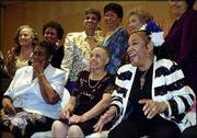 Clora Bryant, right front, breaks out laughing as the Prairie View Co-Eds gather for a group picture during a reception in their honor in Houston. The members of the historic Prairie View A&M all-girl jazz band gathered for the first time in more than 50 years for a two-day celebration held by the university in their honor. Back row from left are Ernest Crafton Miller, Argie Mae Edwards Medearis, Izola FedFord Collins, Elizabeth Thomas Smith and Marion Bridges Simon; front row, from left, are Helen Cole, Fannie Drisdale Burt and Bryant.