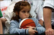 Caitlyn Benedetto, 8, Dennison, Ohio, waits anxiously for autographs near the end of the KU open practice session. Benedetto hoped to get coach Roy Williams to sign her basketball Friday at the Georgia Dome.