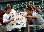 "Rating ""the Gooden, the Bad and the Ugly,"" Kansas fans display a sign for TV cameras. This group was mugging for the cameras Friday during an open practice session at the Georgia Dome."