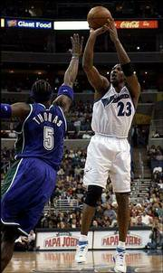 Washington's Michael Jordan, right, shoots over Milwaukee's Tim Thomas. Jordan hit 12 of 22 shots in the Wizards' 107-98 victory Friday night in Washington.
