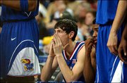 Kirk Hinrich watches from the bench during the final minutes of KU's loss to Maryland. Hinrich fouled out in the second half.