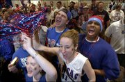 Kansas University students, from left, Alex Stout, Jeff Wyssenbach and Megan Haas, all Wichita sophomores, and Mike Crawford, a St. Louis junior, join in a Rock Chalk cheer. The four were taking part in a pregame KU pep rally Saturday at the J.W. Marriott Hotel in Atlanta.