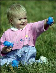 Kaelyn Weiss, 16 months, collects plastic eggs during an Easter egg hunt at South Park. Eggs were exchanged for candy prizes during Saturday's outdoor hunt sponsored by Lawrence Parks and Recreation and Hy-Vee Food Stores.