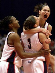 Connecticut's Asjha Jones, left, Diana Taurasi (3) and Sue Bird celebrate the Huskies' 82-70 victory over Oklahoma in the NCAA women's title game Sunday night in San Antonio.