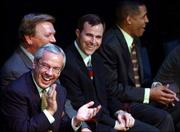 Kansas coaches, from left, Roy Williams, Joe Holladay, Ben Miller and Neil Dougherty laugh at comments made by Max Falkenstien during the Jayhawks' award ceremony.