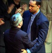 Kansas' Drew GOoden, right, gets emotional as he hugs coach Roy Williams.
