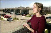 Vacancy rates are low and the Lawrence apartment market appears in healthy shape, according to people in the business. Lizabeth Luck, photographed Tuesday at a west Lawrence apartment complex, is a property manager for Master Plan Management. Luck agreed occupancy rates in Lawrence are healthy.