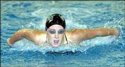 FREE STATE'S KELLI CRISWELL takes a breath during the 100 butterfly competition during the Firebirds' quadrangular meet. Criswell placed third Tuesday at Lawrence Indoor Aquatic Center.