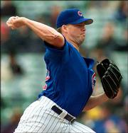 Cubs starter Jon Lieber throws against the New York Mets. Lieber allowed two hits over eight innings as the Cubs won, 2-0, on Tuesday in Chicago.