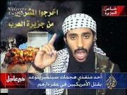 "In this image taken from video broadcast by the Al-Jazeera satellite television network, a man who was identified by Al-Jazeera&squot;s editor-in-chief as Ahmed Ibrahim A. Alhaznawi speaks in an undated video tape. Al-Jazeera editor-in-chief Ibrahim Hilal said the excerpts presented Monday were from an hour-long video, complete with narration and graphics, delivered by hand to the station&squot;s Doha, Qatar offices a week ago. Superimposed caption at bottom center reads, ""One of the implementors of the Septebmer attacks threatens to kill Americans in their homes."""