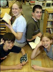 "Four West Junior High eighth-graders have had their haiku poetry published in a handmade book titled ""Kaw Valley Haiku."" Pictured at WJHS are, from left, Karl McDonald, Hannah Zingre, Patrick Green and Emma Brooke. The books were made by Tim and Jenny O&squot;Brien of Lawrence."