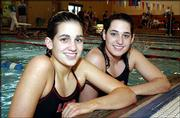 Melissa, left, and Megan Little helped Lawrence High win its only home swim meet of the season. The Little sisters figured in 140 points as the Lions won a five-team meet Tuesday at Knox Natatorium.
