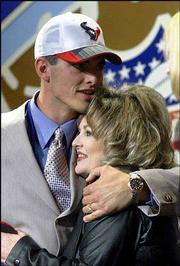 Fresno State quarterback David Carr gets a hug from his mother, Sheryl, after being selected as the No. 1 overall pick.