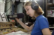 """Student Disc jockey Becky Lake announces the play list during her """"Friday Freebies"""" rock music set at Kansas University's KJHK 90.7 FM radio station. Lake, a Stilwell senior, was photographed Friday. Radio stations like KJHK that broadcast music on the Internet may soon be required to pay yearly royalty fees."""