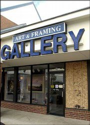 Plywood stands in place of a shattered window at Roy's Gallery, 1410 Kasold Drive. Late Saturday or early Sunday, a thief broke the gallery window and took a $3,500 sculpture by Lawrence artist Jim Brothers.