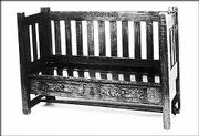 This 60-inch-long hall bench has 10 slats and two drawers. The Roycroft mark is prominently branded on the front of the seat rail. It sold last year at a Treadway Gallery auction for $19,550.