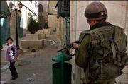 Under the watchful eye of an Israeli soldier securing an area, a Palestinian girl walks by in the old city of Bethlehem. In Israel proper, Arab citizens of Israel say they are coming under increasing scrutiny.