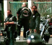 Bikers wearing Hells Angels colors gather in a parking lot at Gretchen's Inn on U.S. Highway 95 in Bullhead City, Ariz., after other Hells Angels members were involved in a shootout at Harrah's casino in Laughlin, Nev. Rival motorcycle gangs armed with guns and knives clashed at the casino early Saturday, leaving three dead and at least 12 wounded.