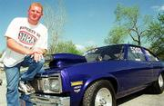 Kevin Miller poses with his 1975 Chevy Nova.