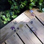 Deck cleaner can remove surface and ground-in dirt from a dingy deck. Use stencils to add decorative details.