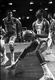 oscar robertson (1) drives to the basket against New York Knicks' Earl Monroe in this Nov. 23, 1973 file photo in Milwaukee.