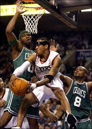 Philadelphia's Allen Iverson, front, drives past Boston's Walter McCarty, left, and Antoine Walker. Iverson had 42 points in the 76ers' 108-103 victory on Sunday in Philadelphia.