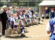 Kansas' eight senior softball players and their families listen as underclassmen players share their memories of the seniors. The ceremony to honor the seniors took place on the infield between games of a doubleheader against Iowa State on Sunday.