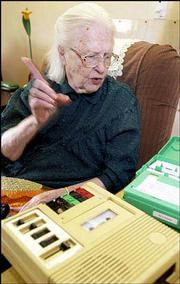 Margaret Hoecker, a 92-year-old resident at Brandon Woods Retirement Community, listens to a book on tape from Talking Books. The program is a federally funded and provides visually impaired, learning disabled and others who are unable to read text with free tape recorders and books on cassette.