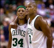 Boston forward Paul Pierce and teammate Antoine Walker share a moment in the third quarter. Pierce had 46 points as the Celtics hammered Philadelphia, 120-87, on Friday in Boston.